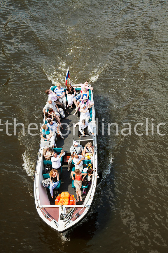 RUSSIA, Moscow. A boat of tourists on the Moscow River.
