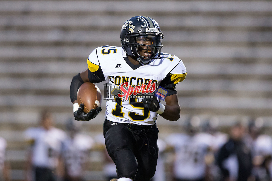 Jourdain Heilig (15) of the Concord Spiders runs with the football during first half action against the Northwest Cabarrus Trojans at Trojan Stadium October 29, 2015, in Concord, North Carolina.  The Spiders defeated the Trojans 30-26.  (Brian Westerholt/Sports On Film)