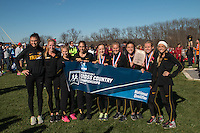 Missouri's women's cross country team pose after the awards ceremony after winning the NCAA Division I Cross Country Midwest Regional in Iowa City, Ia. Friday November 11, 2016. The win was the first victory at the meet for the program since 2003, and qualiifed them for the NCAA Championship meet for the first time since 2004.