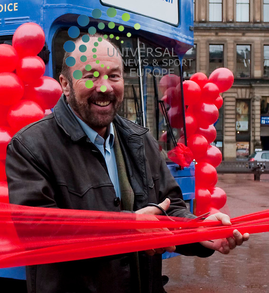 "Brian Souter, Stagecoach Group chief executive cuts a ribbon as he unveils a scheme in conjunction with BMI Healthcare which will see a ""Healthy Heart Bus"" visit depots around the country to check the wellbeing of bus drivers..George Square, Glasgow, G21 3UW. Picture: Euan Anderson/Universal News And Sport (Scotland) 25th February 2010."