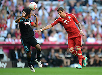 FUSSBALL   1. BUNDESLIGA  SAISON 2012/2013   7. Spieltag FC Bayern Muenchen - TSG Hoffenheim    06.10.2012 Marvin Compper (li, TSG 1899 Hoffenheim) gegen Mario Mandzukic (FC Bayern Muenchen)