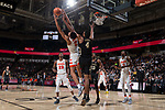 Doral Moore (4) of the Wake Forest Demon Deacons fights for the ball with Matthew Moyer (2) of the Syracuse Orange during second half action at the LJVM Coliseum on January 3, 2018 in Winston-Salem, North Carolina.  The Demon Deacons defeated the Orange 73-67.  (Brian Westerholt/Sports On Film)