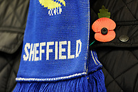 A red poppy next to a Sheffield United scarf priorto the Sky Bet Championship match between Sheffield Wednesday and Swansea City at Hillsborough Stadium, Sheffield, England, UK. Saturday 09 November 2019