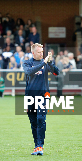 Brentford manager, Dean Smith applauds the fans during the Carabao Cup match between AFC Wimbledon and Brentford at the Cherry Red Records Stadium, Kingston, England on 8 August 2017. Photo by Carlton Myrie.