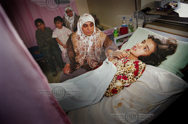 © Martin Adler / Panos Pictures.04/2003. REPUBLICAN HOSPITAL, MOSUL, IRAQ. Amina Saad was injured by an bullet during anti-American demonstrations in Mosul. The bullet damaged her spine and she is now paraplegic.