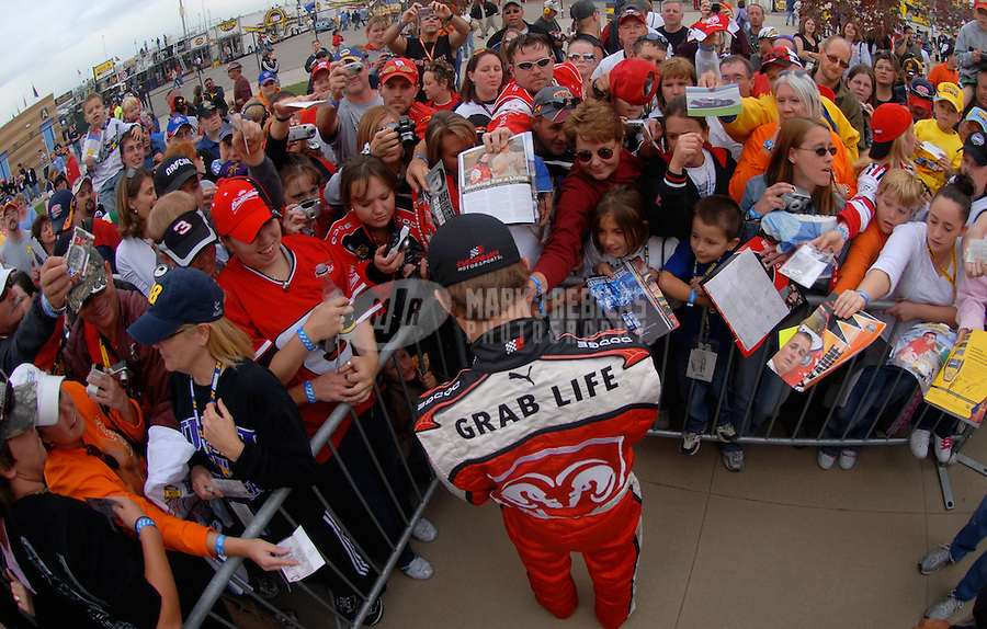 Sept. 29, 2006; Kansas City, KS, USA; Nascar Nextel Cup driver Kasey Kahne (9) signs autographs after qualifying on the pole for the Banquet 400 at Kansas Speedway. Mandatory Credit: Mark J. Rebilas