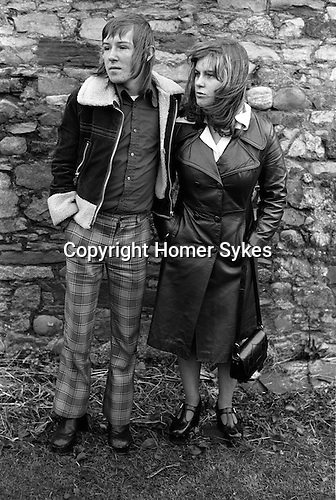Fashionably dressed young teenage couple. Margaret and Barry Kirkbride.  Workington Cumbria, The Lake District, England 1975.<br /> <br /> 20X16 PARIS 2015 LES DOUCHES LA GALERIE <br /> <br /> THIS ARE MEDIUM RES FILES ONLY FOR REFERENCE AND SHOULD NOT BE SENT OUT THEY OPEN AT 11MGB