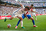 Marcelo Vieira Da Silva (l) of Real Madrid competes for the ball with Yannick Ferreira Carrasco of Atletico de Madrid during their La Liga match between Real Madrid and Atletico de Madrid at the Santiago Bernabeu Stadium on 08 April 2017 in Madrid, Spain. Photo by Diego Gonzalez Souto / Power Sport Images