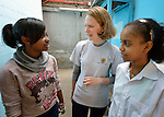 Beth Frank, a program monitoring and evaluation specialist for Church World Service, talks with young refugees in Cairo, Egypt. The children attend a school operated by St. Andrew's Refugee Services, which is supported by Church World Service.