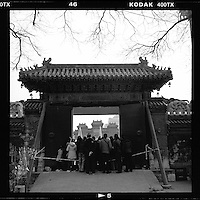 Chinese revellers watch traditional acrobat performance at a temple fair during the Chinese New Year in Beijing, China, February, 2013. (Mamiya 6, 75mm, Kodak TRI-X film)