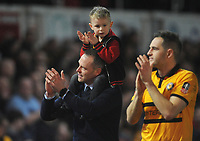 Newport County manager Michael Flynn celebrates at the final whistle with his son on his shoulders alongside player Matthew Dolan<br /> <br /> Photographer Ian Cook/CameraSport<br /> <br /> The Emirates FA Cup Third Round - Newport County v Leicester City - Sunday 6th January 2019 - Rodney Parade - Newport<br />  <br /> World Copyright &copy; 2019 CameraSport. All rights reserved. 43 Linden Ave. Countesthorpe. Leicester. England. LE8 5PG - Tel: +44 (0) 116 277 4147 - admin@camerasport.com - www.camerasport.com