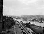 Pittsburgh PA:  View looking south towards the South Side and Monongahela River from the bluff at Duquesne University- 1932.  View includes the construction of the 10th Bridge which opened to traffic in 1933.