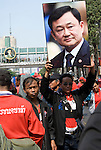 Bangkok, Jan 23: Image of depsoed leader Thaksin Shinawatra juxtaposed along side the image of His Majesty King Bhumibol Adulyadej as the United Front for Democracy against Dictatorship (UDD) Red Shirt protestors rally at Ratchapraong intersection in central Bangkok before marching to Democracy Monument. Red Shirt leaders vowed to rally two times each month to commemorate the military crackdowns on protestors last year. Bangkok, January 23, 2010.