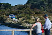 BNPS.co.uk (01202 558833)<br /> Pic: ZacharyCulpin/BNPS<br /> <br /> The land train in action at Hengistbury Head<br /> Passengers have hit out at a 'farcical' council-run land train at a beauty spot after a driver shortage put it out of action for the ninth time in three months.<br /> <br /> The popular Hengistbury Head Land Train in Dorset has already been besieged by a series of mechanical failures over the summer.<br /> <br /> Now, the stricken service, which is overseen by BCP Council, has suffered further ignimony as it was forced to shut down for three days to enable their only available driver to do some 'mandatory training'. This had been arranged at the same time that their second driver was on annual leave.<br /> <br /> The novelty 'Noddy' train service, which takes thousands of visitors a year 1.5 miles from the car park at the Hengistbury Head nature reserve to Mudeford Spit, was launched by the late Joyce and Roger Farris in 1968.<br /> <br /> It was operated independently, running for 364 days a year, until it was controversially taken over by the local council in 2015 who terminated their contract.