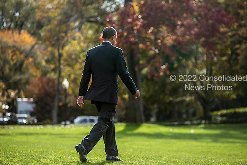 President Barack Obama walks to Marine One as he departs the White House on Saturday, October 27, 2012 in Washington, DC. Obama is traveling to New Hampshire for a campaign event..Credit: Brendan Hoffman / Pool via CNP
