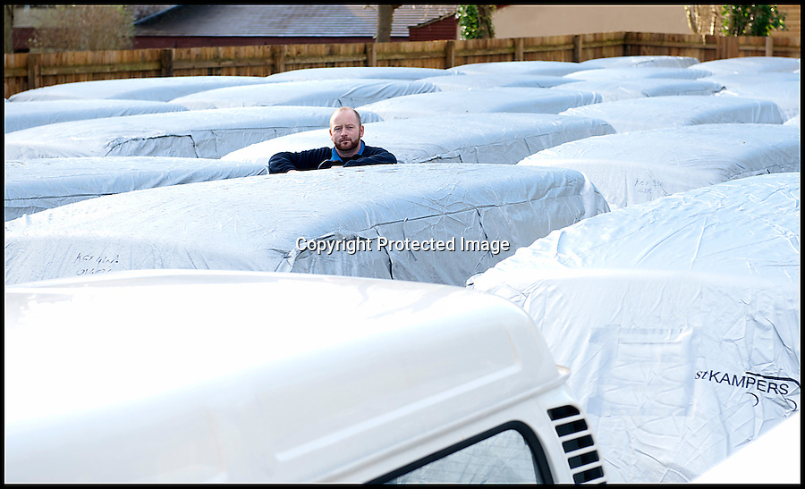 BNPS.co.uk (01202 558833)<br /> Pic: LauraJones/BNPS<br /> <br /> Production manager Matthew Bees with some of the last delivery of VW campervans. <br /> <br /> The last ever delivery of brand new Volkswagen campervans has arrived in Britain marking the end of an era for the iconic 'hippy bus'.<br /> <br /> Ninety nine of the final batch of vans rolled off the production line and onto a container ship bound for British shores after manufacture ceased for good in Brazil in December.<br /> <br /> And though the consignment has only just arrived, almost all of the vans have already been snapped up by eager buyers happy to fork out the £35,000 starting price.<br /> <br /> They are the last brand new campers in all of Europe.