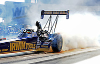 Sept. 17, 2010; Concord, NC, USA; NHRA top fuel dragster driver Doug Herbert does a burnout during qualifying for the O'Reilly Auto Parts NHRA Nationals at zMax Dragway. Mandatory Credit: Mark J. Rebilas/