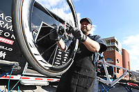NWA Democrat-Gazette/J.T. WAMPLER Eric Fostvedt, ((CQ)) a bike mechanic from Denver, makes sure a bike wheel is ready to go Monday Feb. 4, 2019 while working on the Fayetteville square. The Hagens Berman Axeon Cycling Team is in Fayetteville this week training for an upcoming race in Columbia. They came to the area at the invitation of Experience Fayetteville for the multitude of cycling opportunities. For more information about the team visit www.axeoncycling.com