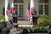 US President Barack Obama and Japan's Prime Minister Shinzo Aba participate in a joint press conference at The White House in Washington DC for a State Visit, April 28, 2015. Credit: Chris Kleponis / CNP