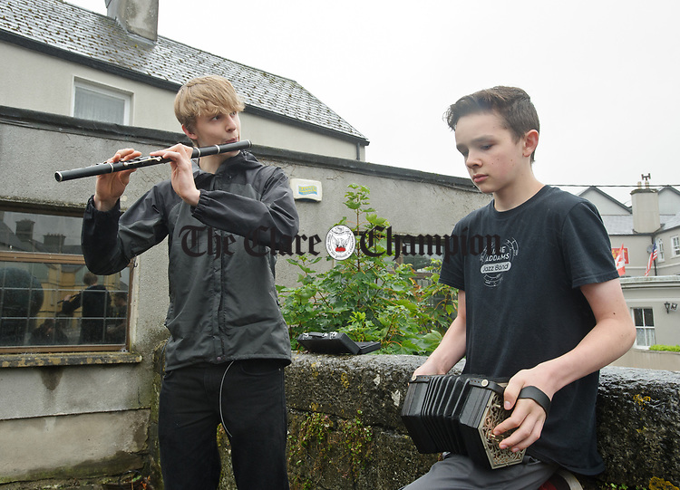 Willie and Owen Bays from Seattle, USA playing at Club Bridge during a wet final Sunday of the All-Ireland Fleadh in Ennis. Photograph by John Kelly.