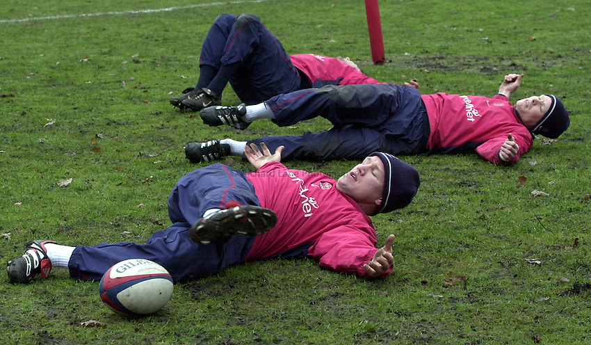 Photo:Ken Brown .28.2.2001 England Rugby Squad training at Sandhurst.Neil Back front the only injury doubt works out