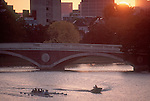 Rowing, Cambridge, Coach coaching eight oared racing shell, Charles River, Weeks Bridge, Harvard University at dawn, Cambridge, Massachusetts, New England, USA,.