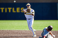 Michigan Wolverines second baseman Hector Gutierrez (24) turns a double play against the Central Michigan Chippewas on March 29, 2016 at Ray Fisher Stadium in Ann Arbor, Michigan. Michigan defeated Central Michigan 9-7. (Andrew Woolley/Four Seam Images)