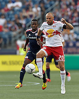 New York Red Bulls midfielder Joel Lindpere (20) redirects the ball. In a Major League Soccer (MLS) match, New England Revolution defeated New York Red Bulls, 2-0, at Gillette Stadium on July 8, 2012.