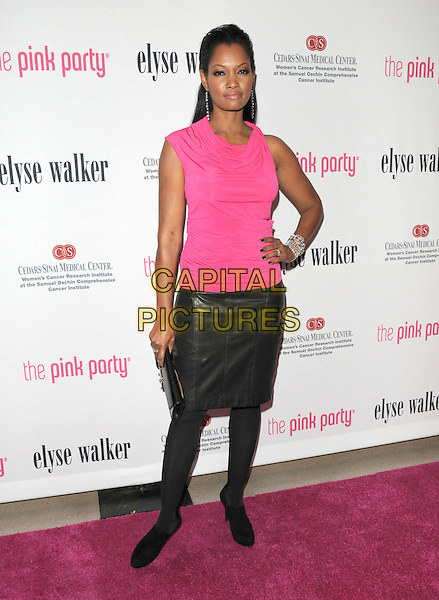 GARCELLE BEAUVAIS-NILON.at The 5th annual Pink Party celebration to Benefit Cedars-Sinai Women's Cancer Research Institute at the Samuel Oschin Comprehensive Cancer Institute, event held at La Cachette Bistro in Santa Monica, California, USA,.September 12th 2009.                                                                   .full length pink top sleeveless hand on hip black leather skirt tights clutch bag shoes booties shoe boots shooboots  ankle  .CAP/DVS.©DVS/RockinExposuresCapital Pictures