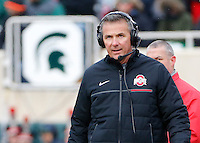 Ohio State Buckeyes head coach Urban Meyer watches the clock during the fourth quarter of the NCAA football game against the Michigan State Spartans at Spartan Stadium in East Lansing, Mich. on Nov. 19, 2016. Ohio State won 17-16. (Adam Cairns / The Columbus Dispatch)