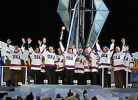 Salt Lake City, UT - During the Opening Ceremony of the Winter Olympics in Salt Lake City, Mike Eruzione and the 1980 Gold medal hockey team stand and wave  before the cauldron as Eruzione hoists the Olympic torch.