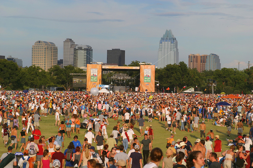 Fans gather at one of the main stages at the Austin City Limits music festival in Austin over looking the Frost Bank Tower Skycraper.<br />