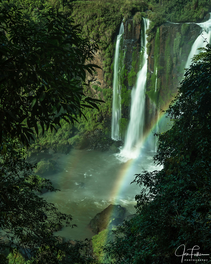 Iguazu Falls National Park in Argentina.  A UNESCO World Heritage Site.  Pictured are the lower Adam and Eve Falls with a rainbow.