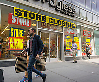 A Payless ShoeSource store in New York advertises its store closing sales on Wednesday, March 22, 2017. A casualty of the over-supply of retail and online shopping, Payless has previously filed for bankruptcy protection and is closing 400 stores.. (© Richard B. Levine)