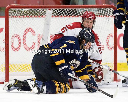 Mike Dalhuisen (Quinnipiac - 2), Luke Greiner (Harvard - 26) - The Harvard University Crimson and Quinnipiac University Bobcats played to a 2-2 tie on Saturday, November 5, 2011, at Bright Hockey Center in Cambridge, Massachusetts.