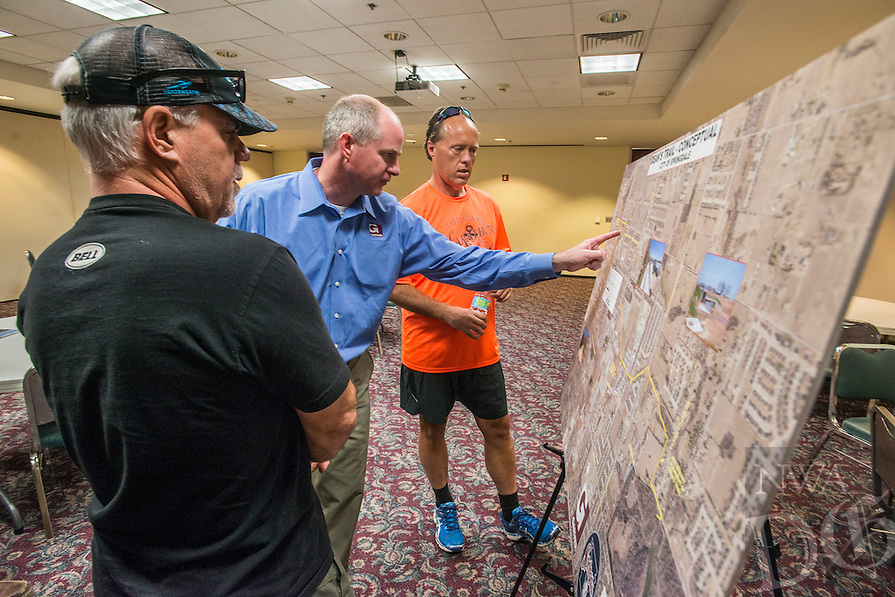 NWA Democrat-Gazette/ANTHONY REYES &bull; @NWATONYR<br /> Steve Scheider (from left), regional director for the International Mountain Bicycling Association, Ron Petrie, senior project manager for Garver, and Keith Sams talk Thursday, June 4, 2015 at a public input session at the Jones Center in Springdale. The session featured possible future routes for the Dean&rsquo;s Trail.