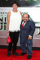 WESTWOOD, LOS ANGELES, CA, USA - AUGUST 03: Amy Buchwald, Danny Woodburn at the Los Angeles Premiere Of Paramount Pictures' 'Teenage Mutant Ninja Turtles' held at Regency Village Theatre on August 3, 2014 in Westwood, Los Angeles, California, United States. (Photo by Celebrity Monitor)