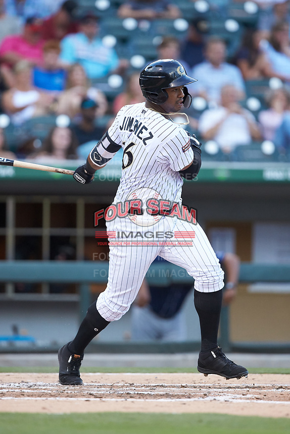 Eloy Jimenez (16) of the Charlotte Knights follows through on his swing against the Toledo Mud Hens at BB&T BallPark on June 22, 2018 in Charlotte, North Carolina. The Mud Hens defeated the Knights 4-0.  (Brian Westerholt/Four Seam Images)