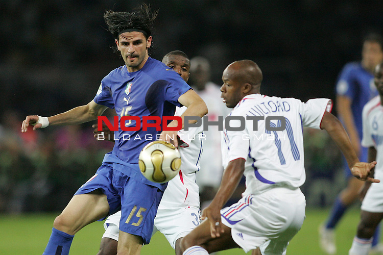 FIFA WM 2006 - Final / Finale<br /> Play #64 (09-Jul) - Italy vs France.<br /> Vincenzo Iaquinta (l) from Italy and Sylvain Wiltford (r) from France fight for the ball during the match of the World Cup in Berlin.<br /> Foto &copy; nordphoto