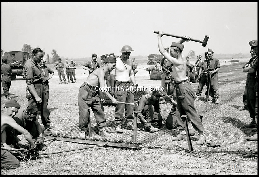 BNPS.co.uk (01202 558833)<br /> Pic: AfterTheBattle/BNPS<br /> <br /> No 5357 ACW laying a 5000ft wire mesh runway near Lingevres.<br /> <br /> A fascinating new book reveals how countless allied airfield's sprang up across the Normandy battlefields post D-day, and were a key element in defeating the Nazi war machine.<br /> <br /> Without a public enquiry or impact statement in sight the Allies constructed paved airstrips as fast as they could to allow the RAF's fighters and bombers to operate in close support of the ground troops.<br /> <br /> Amazingly these bases were thrown up in days and would then sometimes be abandoned just weeks later as the front crept eastward towards Germany.<br /> <br /> Today hardly any mark has been left in the landscape to show where they were briefly situated during 1944.