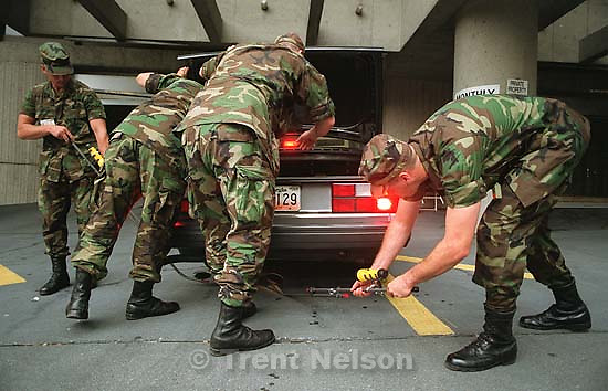 Security personnel check a car at the 1996 Summer Olympic Games<br />