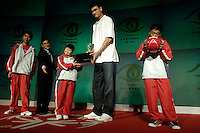 Chinese NBA star Yao Ming presents gifts to Special Olympics athletes at a Special Olympics event in Beijing.<br /> <br /> photo by Lou Lin Wei / Sinopix