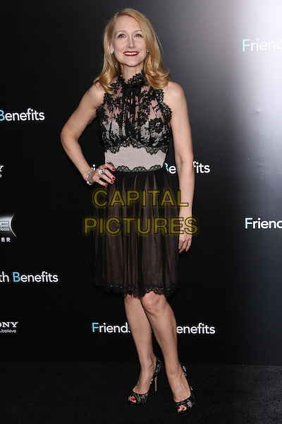 "Patricia Clarkson.The New York Premiere of ""Friends With Benefits"" at the Ziegfeld Theater, New York, NY, USA..July 18th, 2011.full length black lace top dress sleeveless skirt hand on hip.CAP/LNC/TOM.©LNC/Capital Pictures."