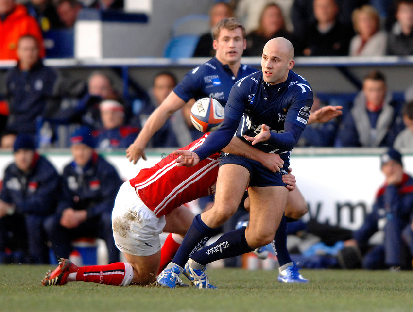 Photo: Richard Lane..Sale Sharks v Llanelli Scarlets. EDF Energy Anglo Welsh Cup. 02/12/2006. .Sale's Daniel Larrechea passes out of the tackle.