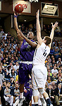 SIOUX FALLS, SD - FEBRUARY 27:  Kebu Johnson #4 from the University of Sioux Falls lays the ball up against Adam Beyer #11 from Augustana during their NSIC Tournament game Saturday night at the Pentagon in Sioux Falls. (Photo by Dave Eggen/Inertia)