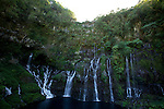 Canyoning in  Langevin waterfall (90 m) La Reunion island