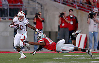 Wisconsin Badgers running back James White (20) gets away from Ohio State Buckeyes linebacker Ryan Shazier (10) during the fourth quarter of the game between Ohio State and Wisconsin at Ohio Stadium on Saturday, September 28, 2013. (Columbus Dispatch photo by Jonathan Quilter)