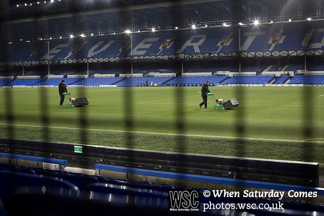 Everton v West Bromwich Albion, 19/01/2015. Goodison Park, Premier League. Two groundsmen with lawnmowers at work after the conclusion of the Premier League match between Everton and West Bromwich Albion at Goodison Park, Liverpool. The match ended in a 0-0 draw, despite the home team missing a first-half penalty by Kevin Mirallas. The game was watched by 34,739 spectators and left both teams languishing near the relegation zone. Photo by Colin McPherson.