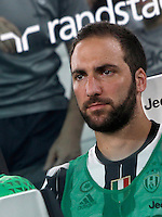 Calcio, Serie A: Juventus vs Fiorentina. Torino, Juventus Stadium, 20 agosto 2016.<br /> Juventus&rsquo; Gonzalo Higuain sits on the bench during the Italian Serie A football match between Juventus and Fiorentina at Turin's Juventus Stadium, 20 August 2016.<br /> UPDATE IMAGES PRESS/Isabella Bonotto