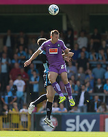 Kelvin Mellor of Plymouth Argyle & Danny Rowe of Wycombe Wanderers go up for the ball resulting in Danny Rowe going down injured during the Sky Bet League 2 match between Wycombe Wanderers and Plymouth Argyle at Adams Park, High Wycombe, England on 12 September 2015. Photo by Andy Rowland.